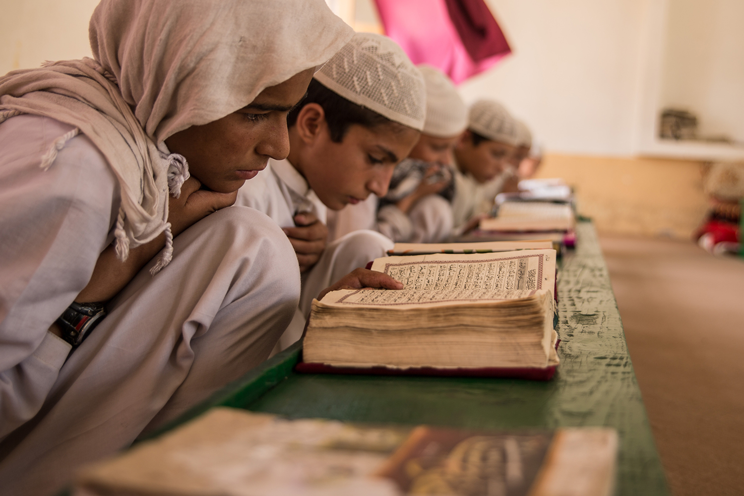 Boys study the Quran at the madrassa in Lamatak village on Sept. 16, 2019.