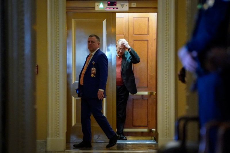 Republican Sen. Lamar Alexander gets into an elevator outside the Senate chamber as the impeachment trial of U.S. President Donald Trump continues at the U.S. Capitol in Washington on Jan. 31.