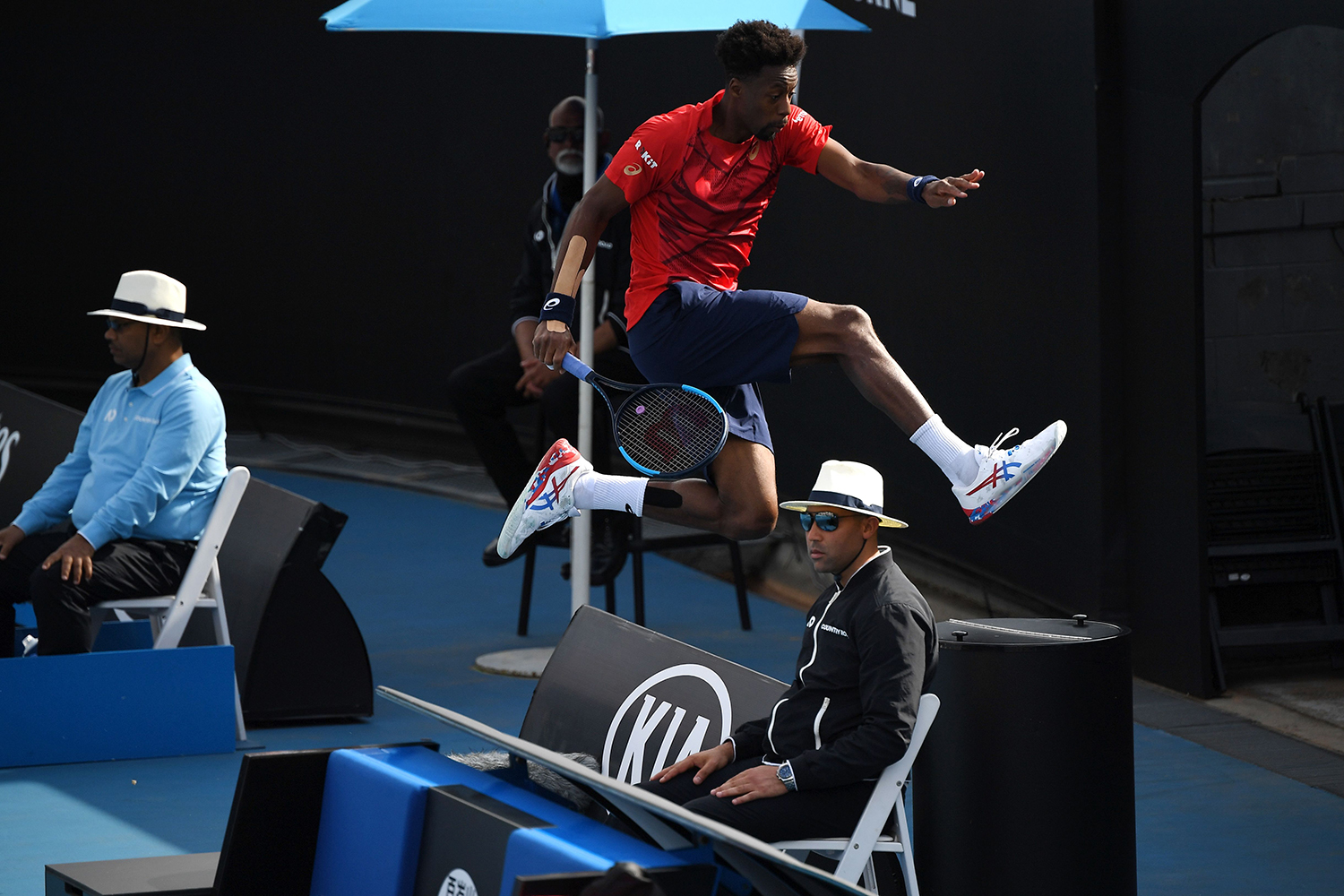 France's Gael Monfils jumps off the court during his men's singles match against Croatia's Ivo Karlovic during the Australian Open tennis tournament in Melbourne on Jan. 23. WILLIAM WEST/AFP via Getty Images