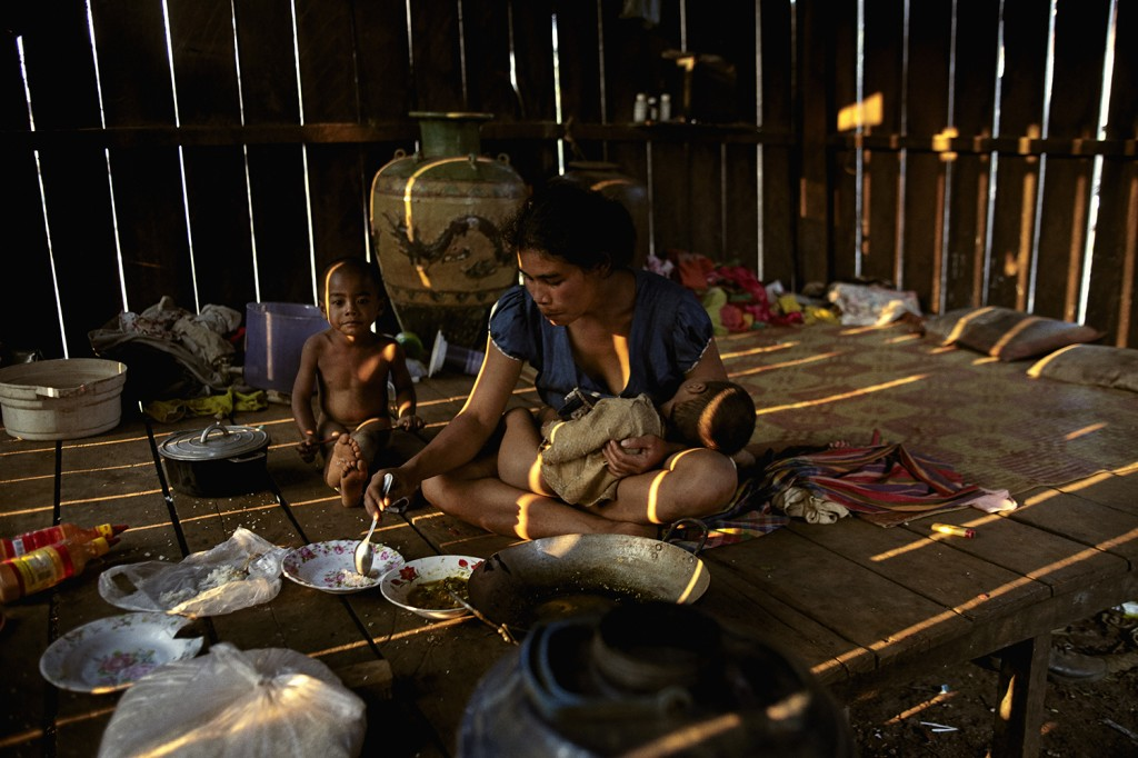Seventeen-year-old Louch Vi feeds her two sons at her hut in the Mondulkiri region of Cambodia on Feb. 9, 2018. Louch said she and her sons go days at a time without food.