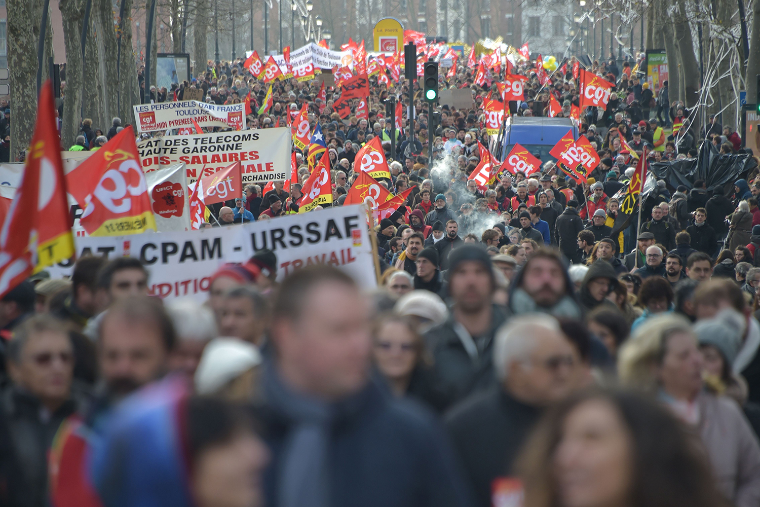 Protesters march during a demonstration as part of the nationwide strike in Toulouse, southern France, on Jan. 16. PASCAL PAVANI/AFP via Getty Images