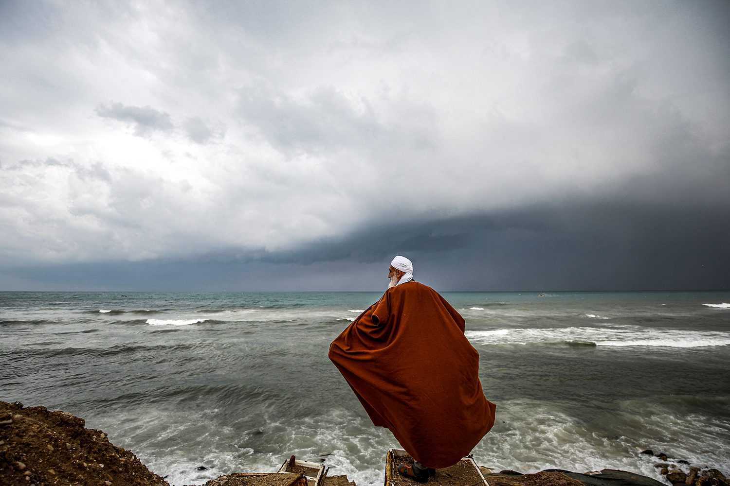 A Palestinian man stands on a beach during stormy weather near his home at al-Shati camp for Palestinian refugees in Gaza City on Jan. 20. MOHAMMED ABED/AFP via Getty Images