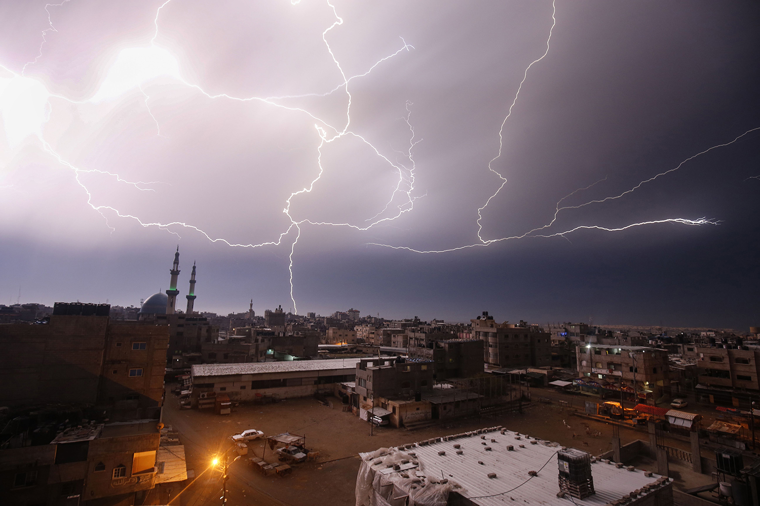 Lightning fills the sky over Rafah in the southern Gaza Strip during heavy rains on Jan. 16. SAID KHATIB/AFP via Getty Images