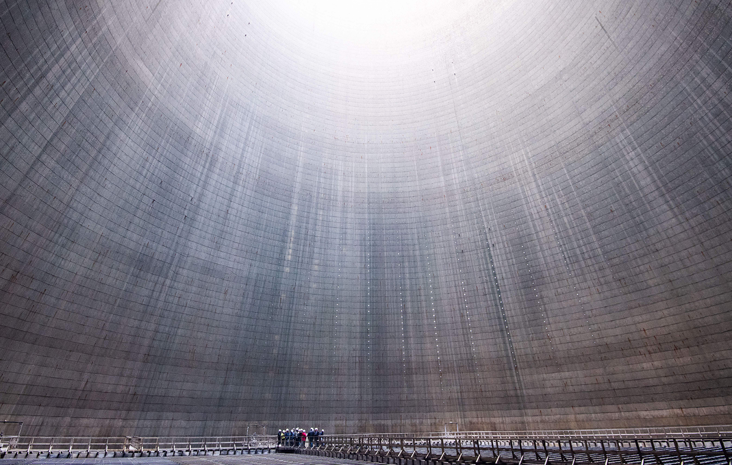 A group visits the inside of a cooling tower at Mehrum coal-fired power plant in Hohenhameln, Germany, on Jan. 16. JULIAN STRATENSCHULTE/dpa/AFP via Getty Images