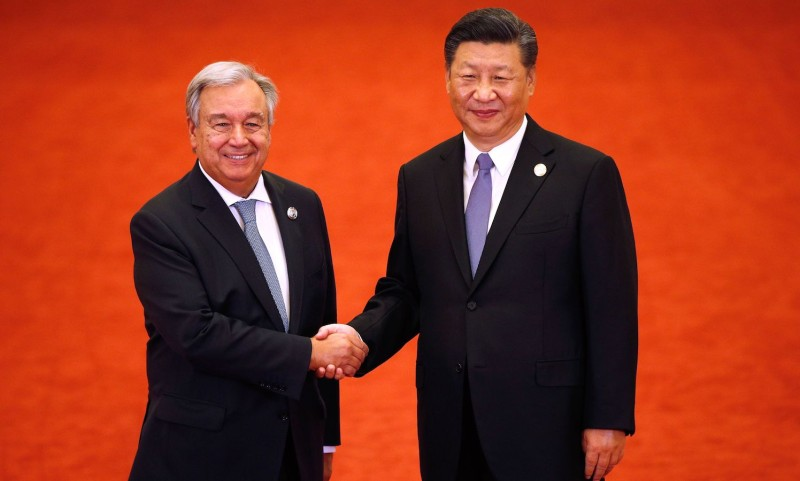 U.N. Secretary-General António Guterres shakes hands with China's President Xi Jinping