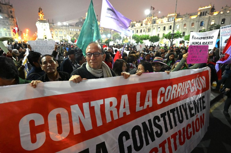 People demonstrate in Lima on Oct. 3, 2019, after President Martin Vizcarra dissolved Peru's unicameral parliament.