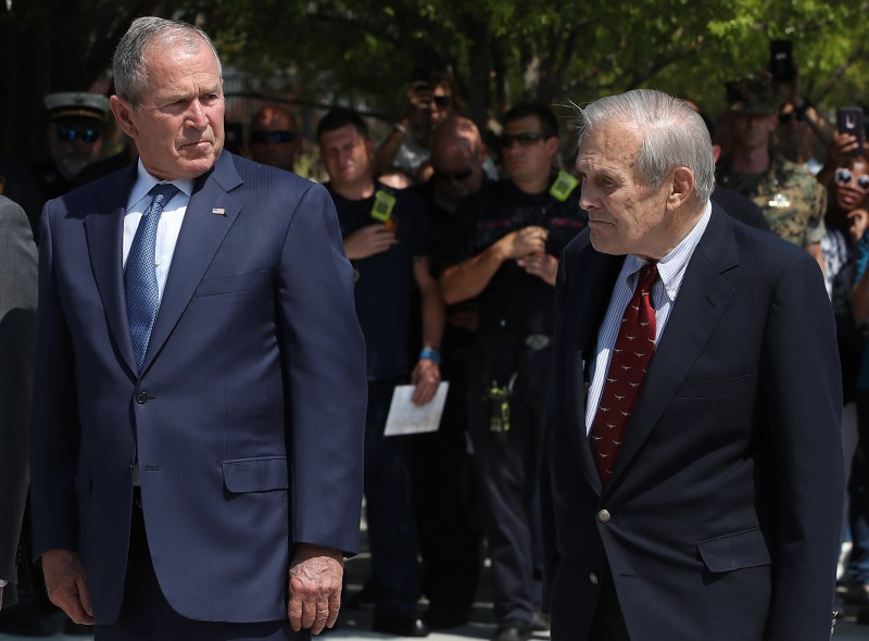 Former U.S. President George W. Bush and former U.S. Secretary of Defense Donald Rumsfeld