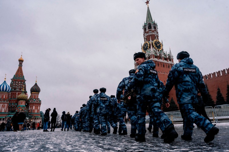 Russian national guard members patrol along Moscow's Red Square on Dec. 30, 2019.
