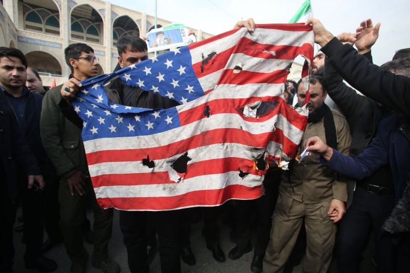 Iranians burn a U.S. flag during a demonstration in Tehran following the killing of Islamic Revolutionary Guard Corps Maj. Gen. Qassem Suleimani