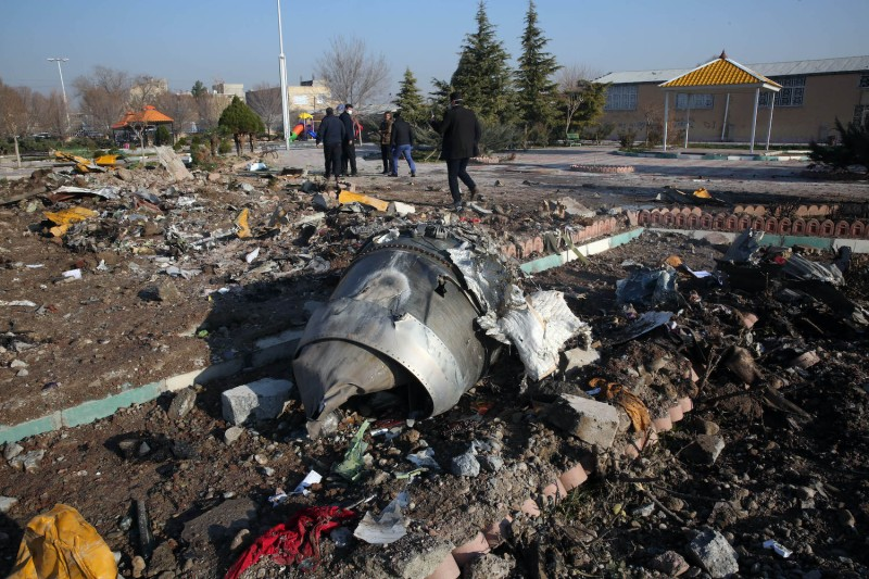 Rescue teams near the site of a Ukrainian plane crash.
