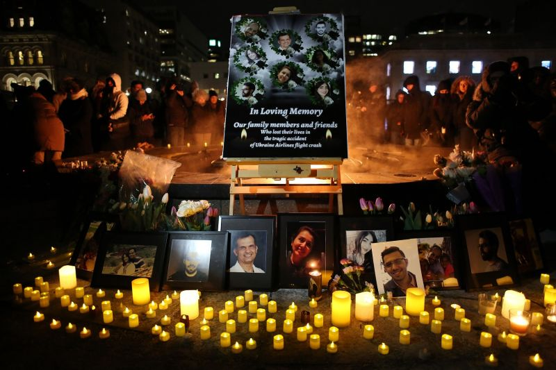 An altar with photographs of the victims who were killed in a plane crash in Iran is seen at a vigil in Ottawa, Ontario, on Jan. 9.