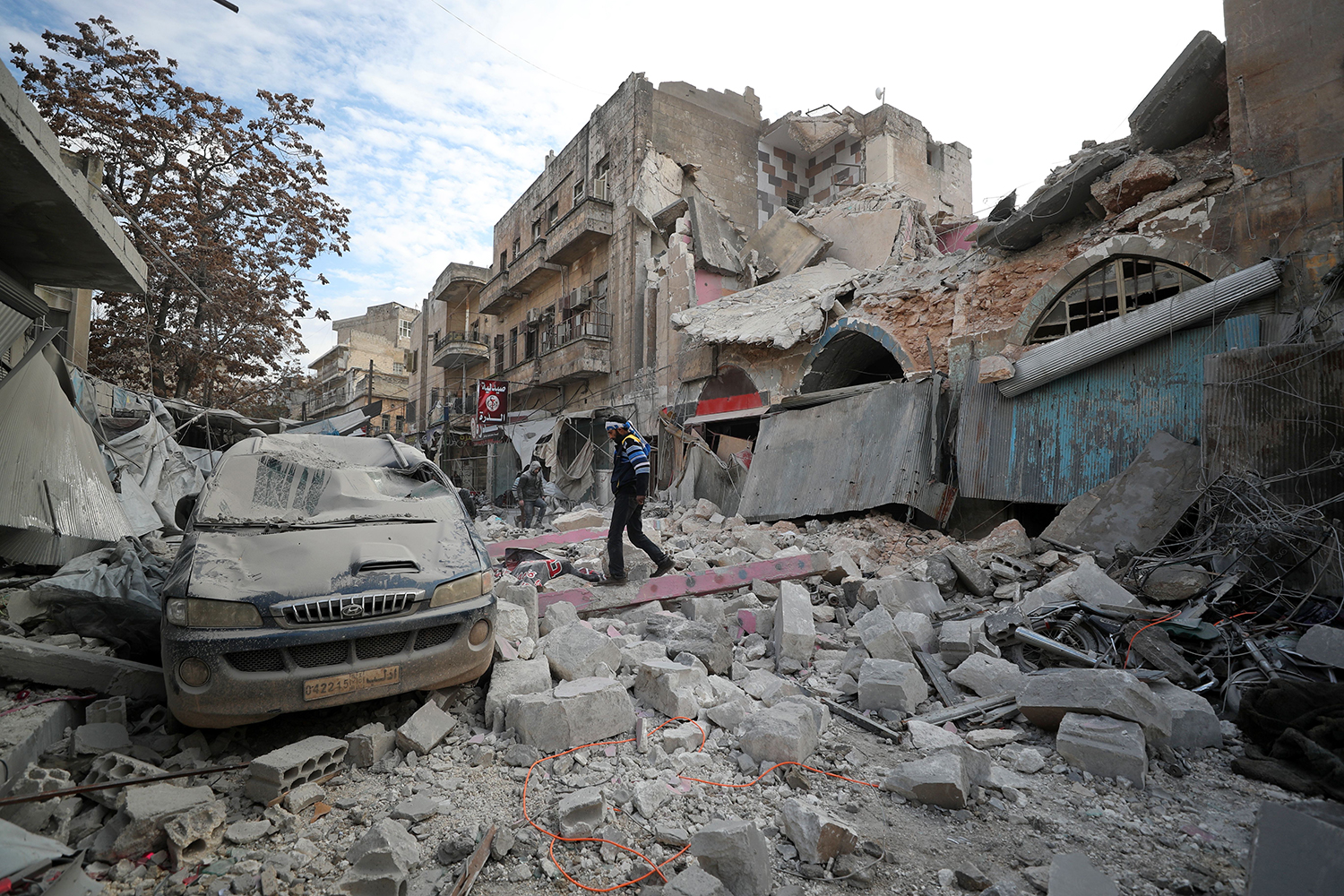 A Syrian walks on the rubble of a building following a regime air strike on Ariha town in Syria's last major opposition bastion of Idlib on Jan. 15. OMAR HAJ KADOUR/AFP via Getty Images