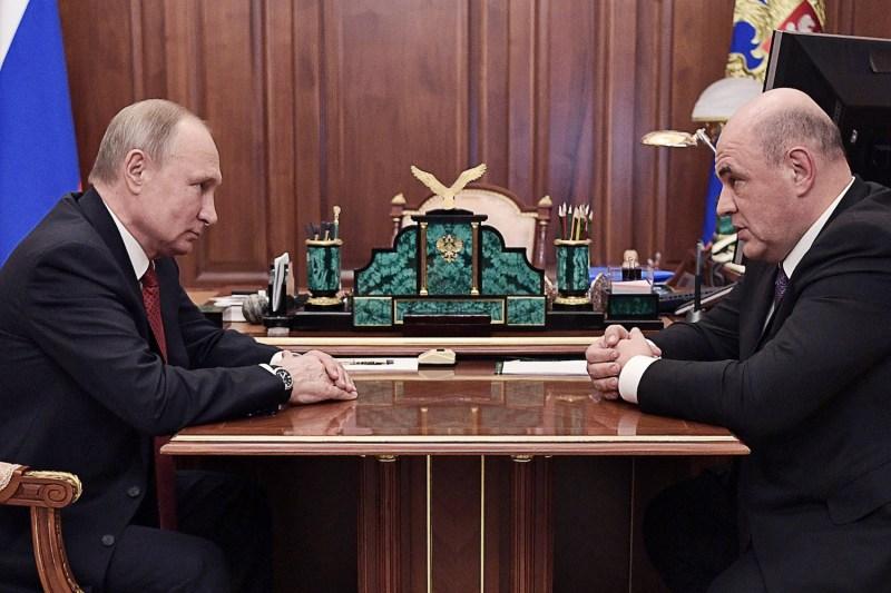 Russian President Vladimir Putin and Mikhail Mishustin