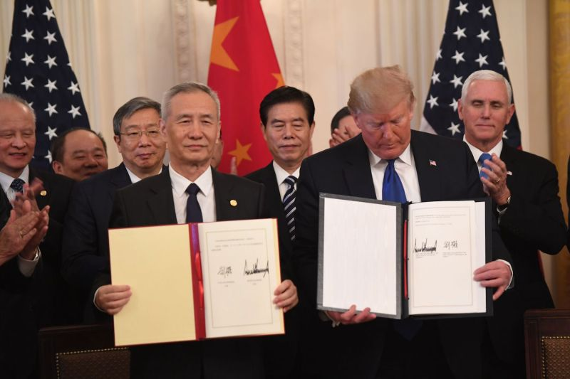 "Chinese Vice Premier Liu He and U.S. President Donald Trump display the signed ""phase one"" trade agreement at the White House on Jan. 15."