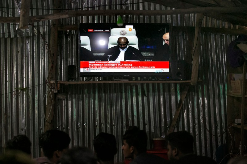 People watch the International Court of Justice hearing at a restaurant in a Rohingya refugee camp