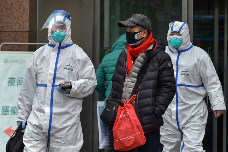 Medical staff walk outside a hospital in Wuhan, China, on Jan. 26.