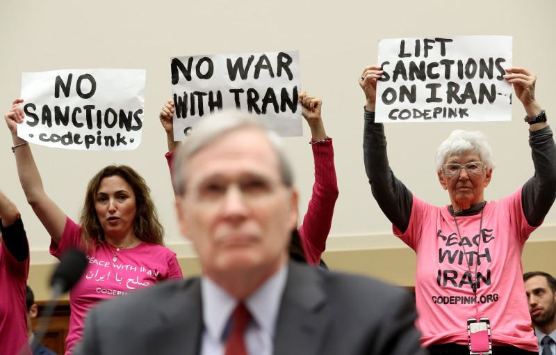 Members of Code Pink protest as Former National Security Advisor Stephen Hadley testifies before the House Foreign Affairs Committee Jan. 14, 2020 in Washington.