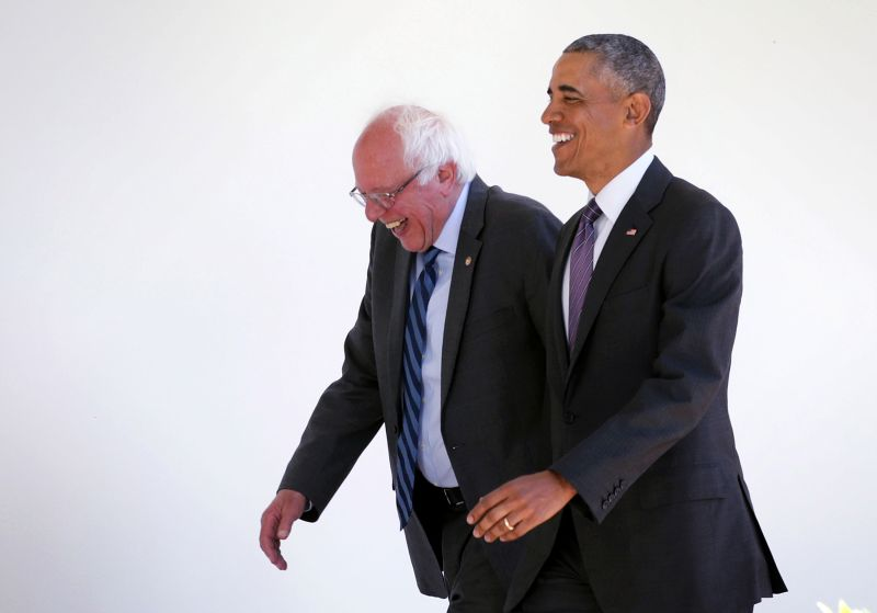 Then-Democratic presidential candidate Sen. Bernie Sanders walks with President Barack Obama as he arrives at the White House for an Oval Office meeting on June 9, 2016.