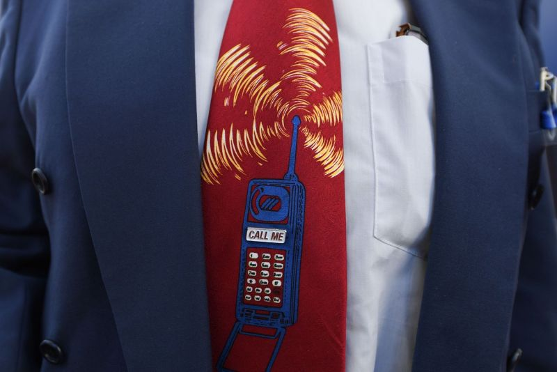 A bidder wears a tie depicting a ringing mobile phone prior to the start of Germany's auction for the construction of an ultra-fast 5G mobile network in Mainz on March 19, 2019.