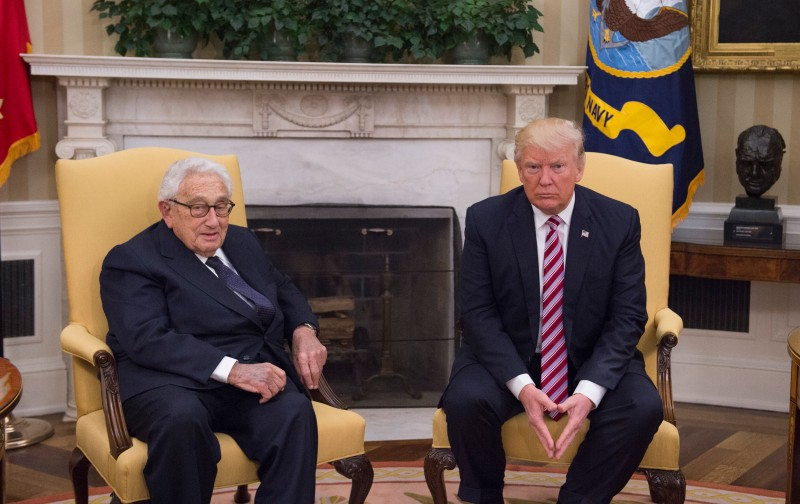 U.S. President Donald Trump meets with former Secretary of State Henry Kissinger in the Oval Office of the White House on May 10, 2017.