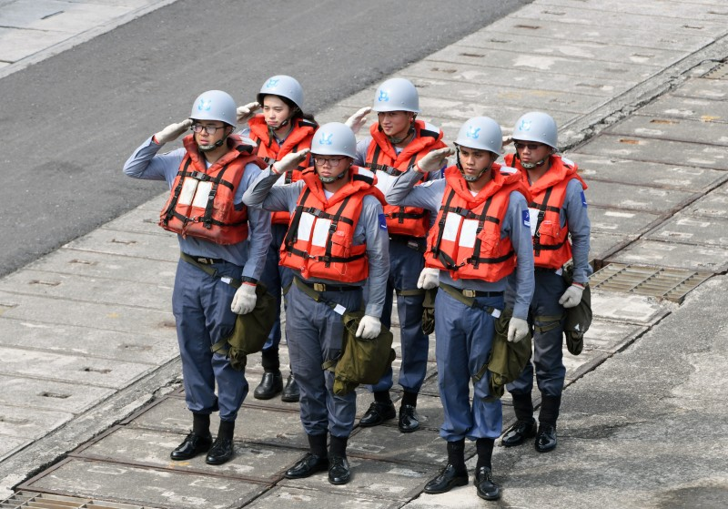 Taiwanese navy personnel salute during a drill near the Suao naval harbor in Yilan, eastern Taiwan, on April 13, 2018.