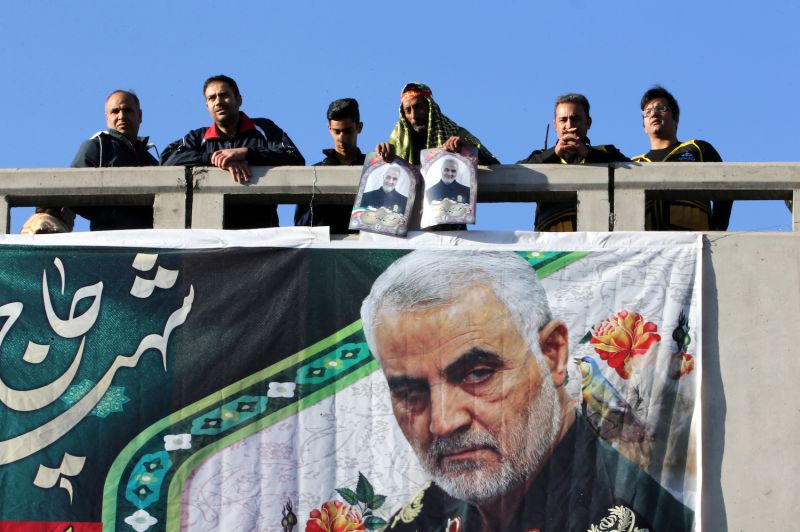 Iranian mourners stand on a bridge during the final stage of funeral processions for Qassem Suleimani in Kerman on Jan. 7.
