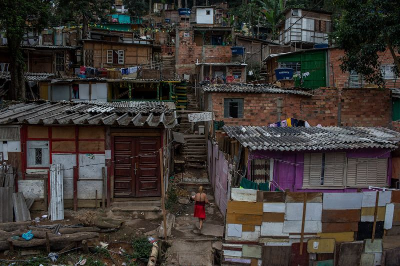 A woman walks upstairs in Jardim Peri, one of the poorest neighborhoods in the city of São Paulo on June 12, 2018.