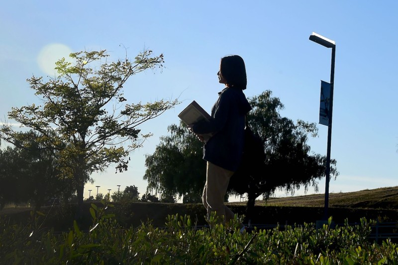 The overseas Chinese student Helen Zhou, from Chengdu, heads to choir practice on campus at Linfield Christian School in Temecula, California, on March 23, 2016.