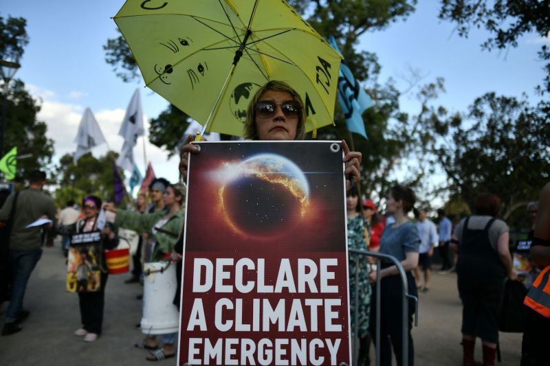 Demonstrators hold up placards outside the Australian Open during a climate protest rally in Melbourne on Jan. 24.