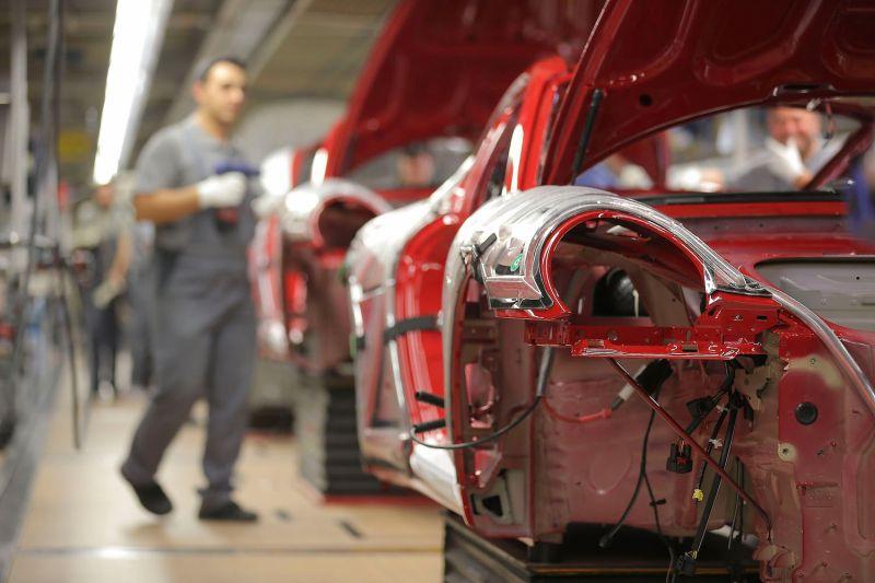 Workers assemble Porsche 911 cars at the Zuffenhausen Porsche production plant in Stuttgart, Germany, on March 10, 2015.