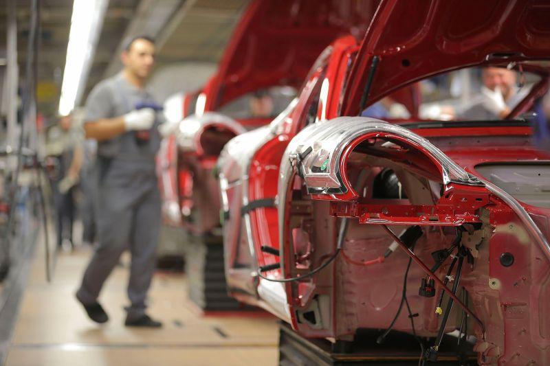 Workers assemble Porsche 911 cars at the Zuffenhausen Porsche production plant in Stuttgart, Germany, on March 10, 2015.