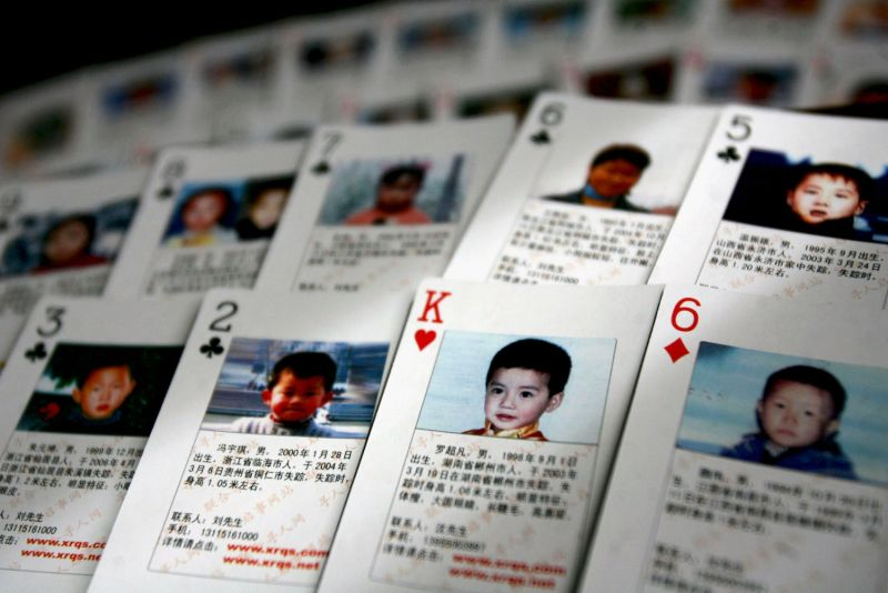 Playing cards showing details of missing children are displayed in Beijing on March 31, 2007.