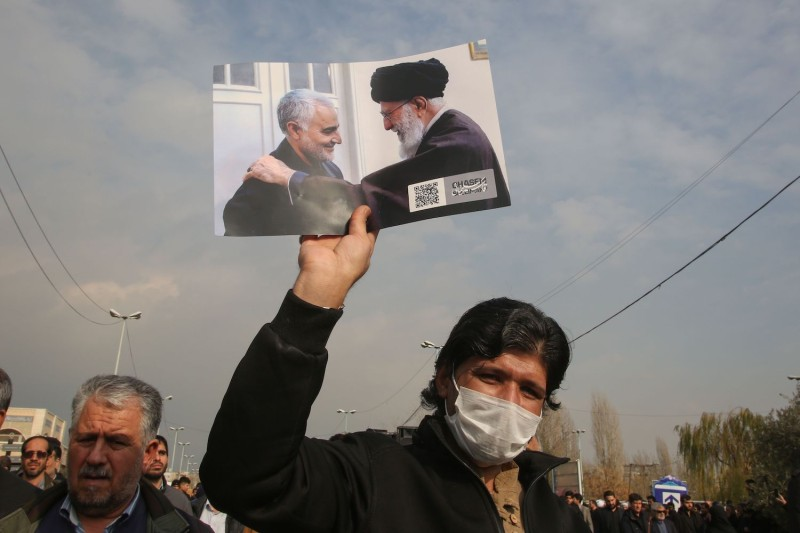 A man holds a picture of Iranian Supreme Leader Ali Khamenei with Islamic Revolutionary Guard Corps Maj. Gen. Qassem Suleimani during a demonstration in Tehran on Jan. 3.
