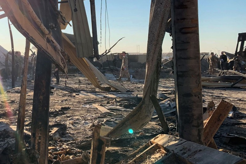A picture taken during a press tour organized by the U.S.-led coalition shows U.S. soldiers clearing rubble at Ain al-Assad military airbase in Anbar province, Iraq, on Jan. 3.