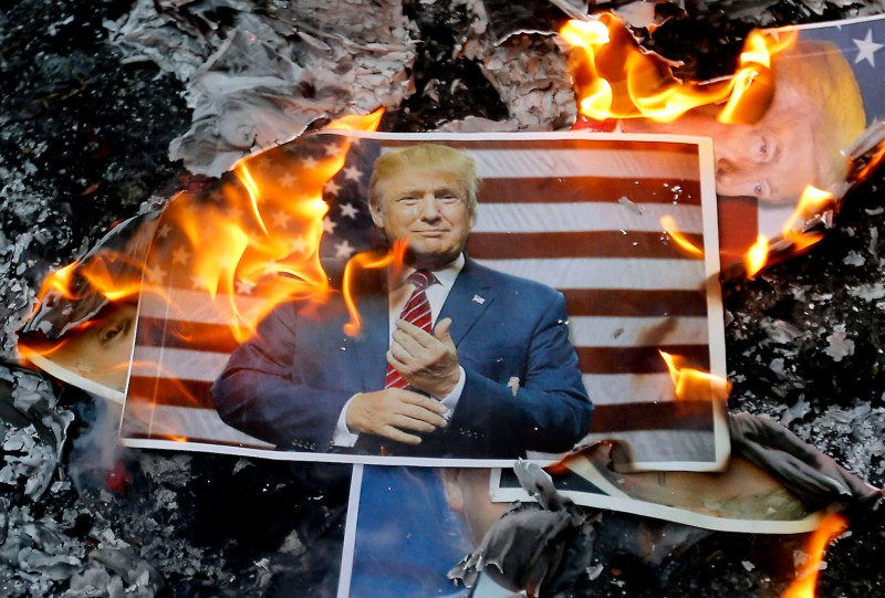 A portrait of U.S. President Donald Trump burns during a demonstration in Tehran on Dec. 11, 2017.