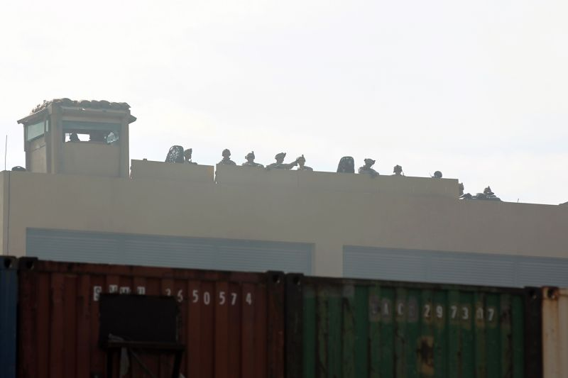 U.S. forces stand guard on the roof of the U.S. Embassy in the Iraqi capital, Baghdad, on Jan. 1.