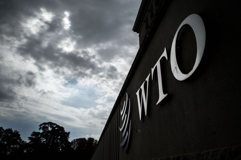 A World Trade Organization sign is seen at WTO headquarters in Geneva on Sept. 21, 2018.