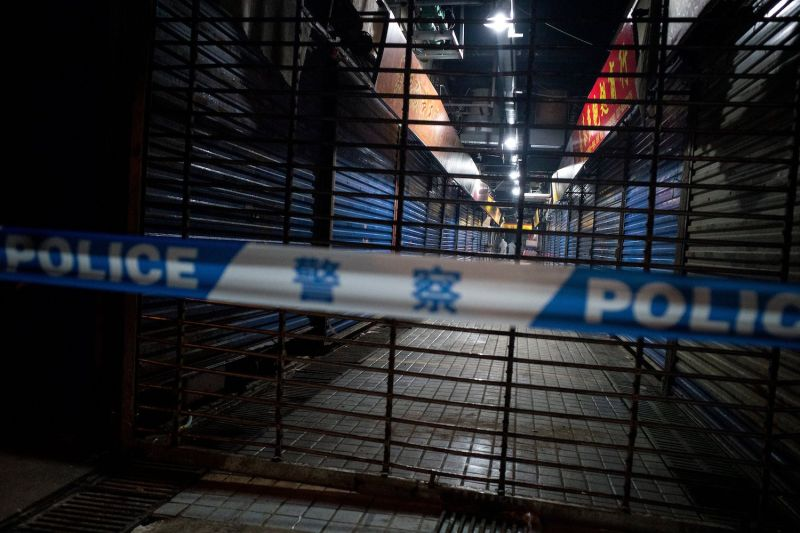 Staff members of the Wuhan Hygiene Emergency Response Team conduct searches on the closed Huanan Seafood Wholesale Market in Wuhan, China, on Jan 11.