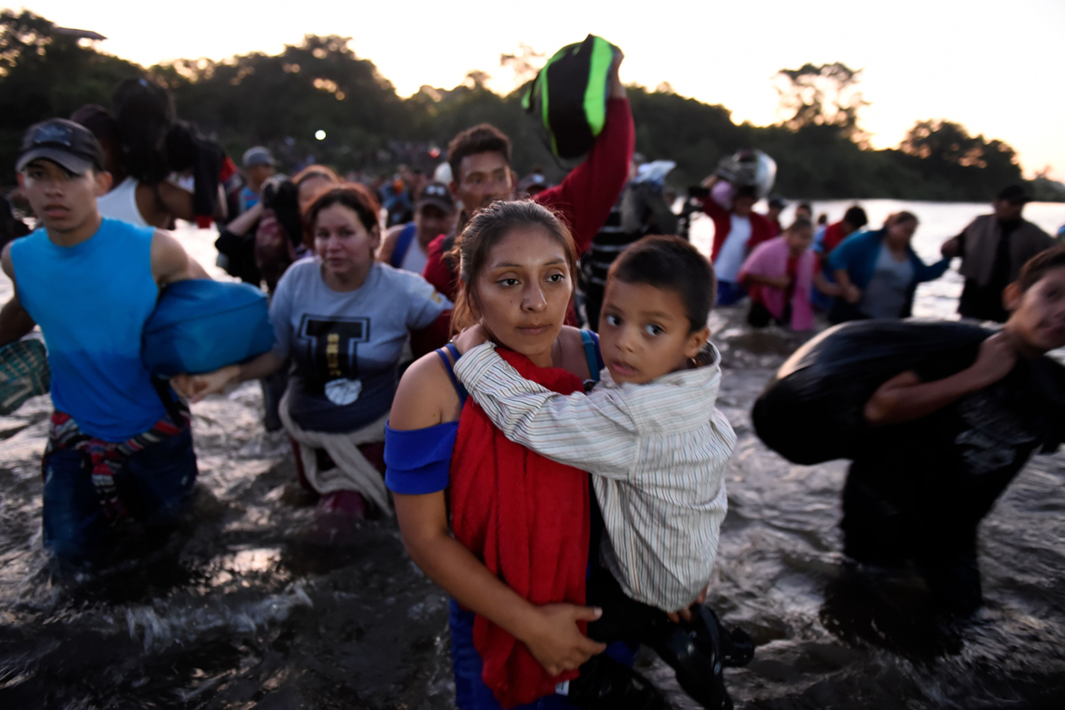 Central American migrants—mostly Hondurans—cross the Suchiate River from Tecun Uman, Guatemala, to Ciudad Hidalgo, Mexico, on their way to the United States on Jan. 23. ALFREDO ESTRELLA/AFP via Getty Images