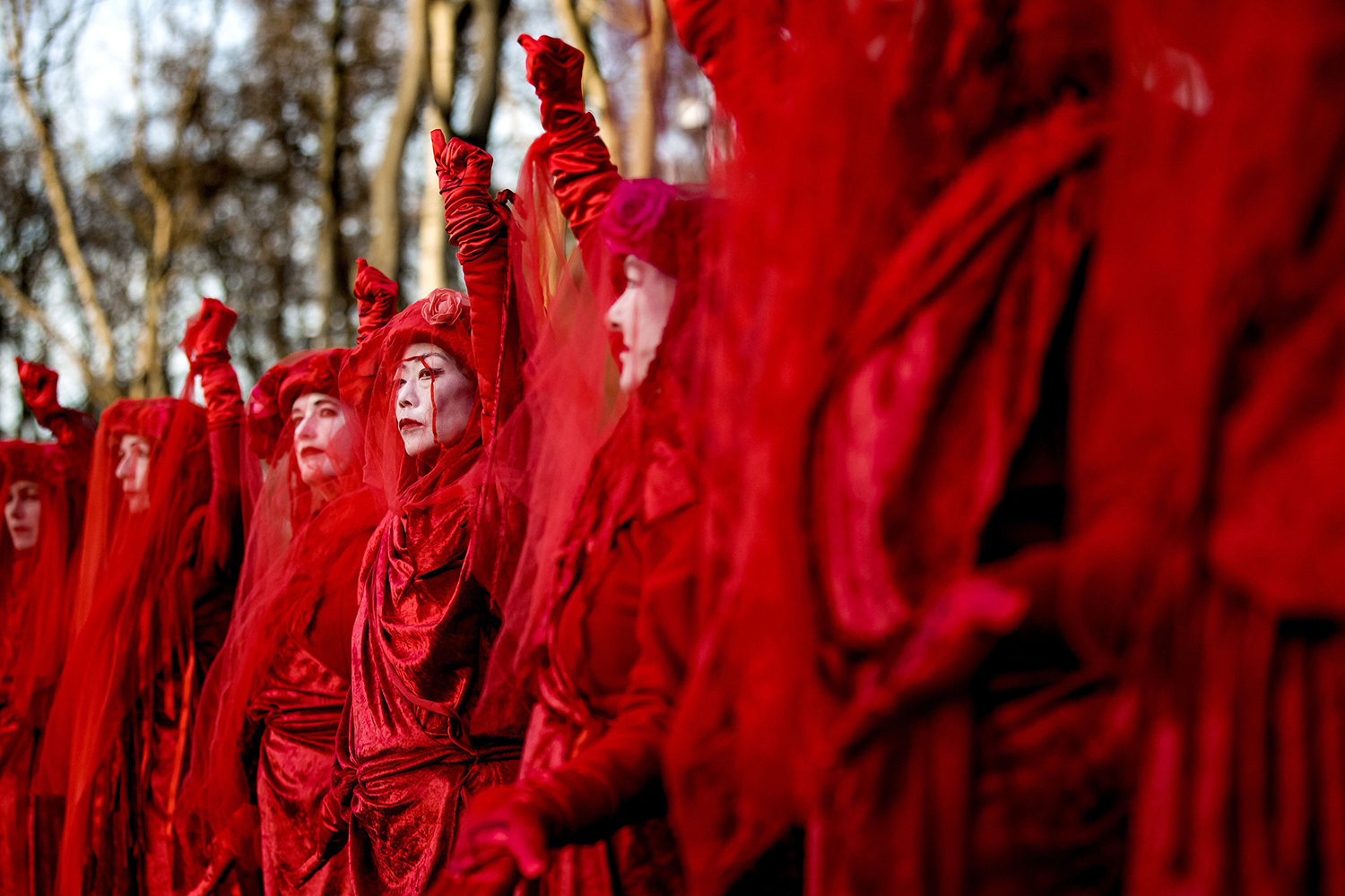 Extinction Rebellion and Red Rebels activists protest during a climate march to the Australian Embassy in The Hague as they take part in a worldwide campaign to draw attention to bushfires in Australia on Jan. 16. KOEN VAN WEEL/ANP/AFP via Getty Images