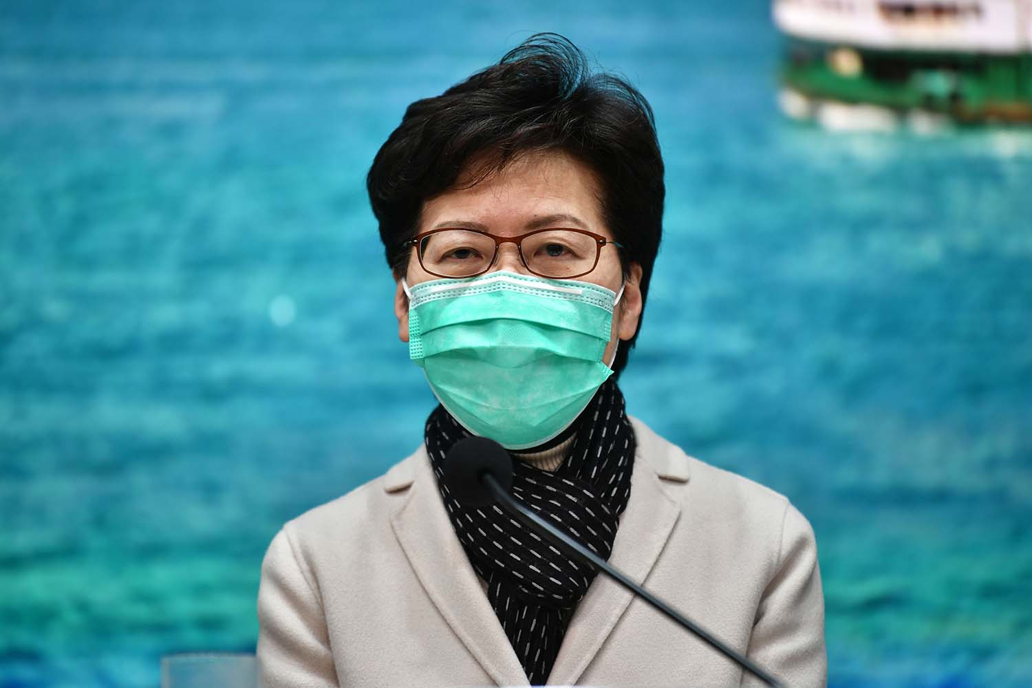 Hong Kong's Chief Executive Carrie Lam wears a face mask during a news conference in Hong Kong on Jan. 28 to update the territory on the coronovirus situation there. ANTHONY WALLACE/AFP via Getty Images