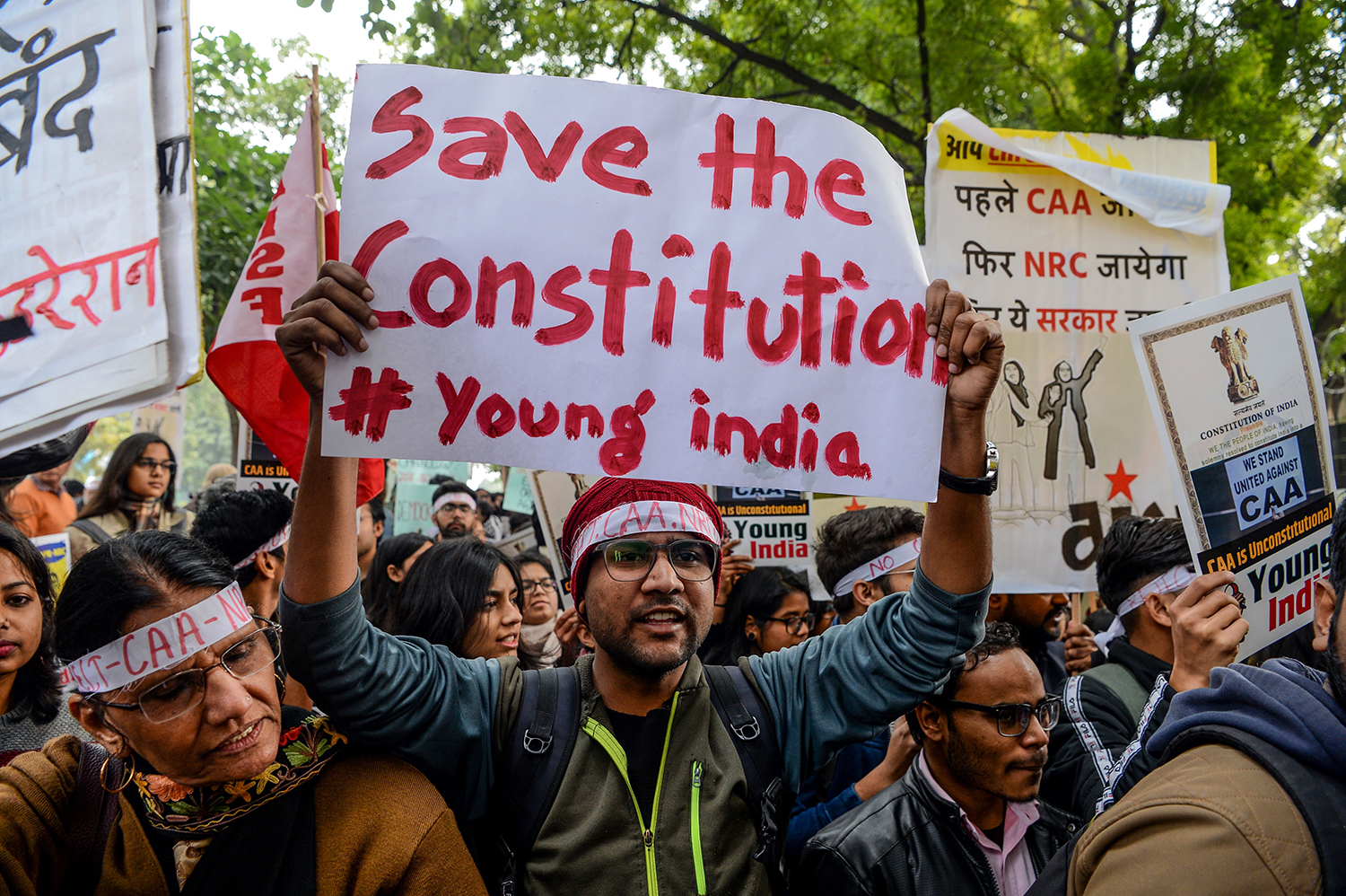 A man holds a placard during a protest against India's new citizenship law in New Delhi on Jan. 20. SAJJAD HUSSAIN/AFP via Getty Images
