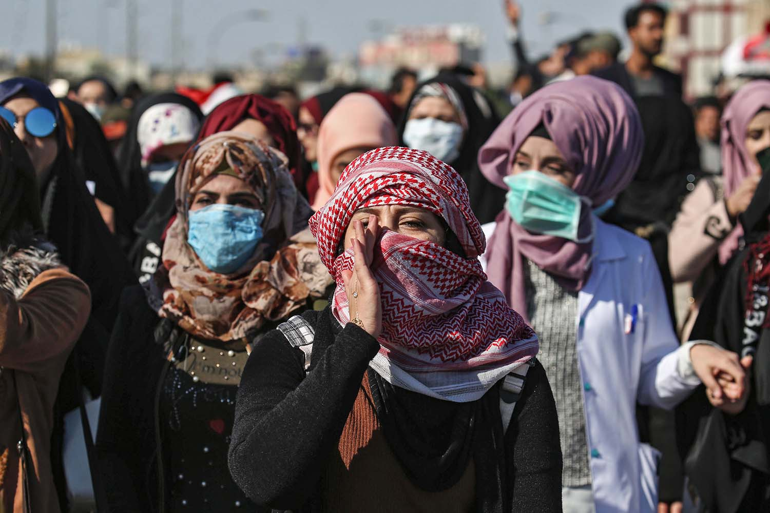 Anti-government protesters chant slogans as they march during a demonstration in the central Iraqi city of Karbala on Jan. 26. MOHAMMED SAWAF/AFP via Getty Images