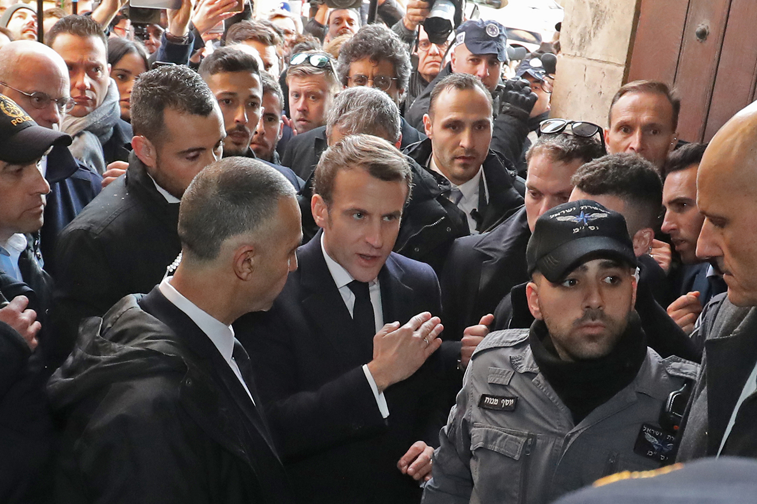 French President Emmanuel Macron asks the Israeli police to leave the 12th century Church of Saint Anne in the old city of Jerusalem on Jan. 22. World leaders are traveling to Israel to mark 75 years since the Red Army liberated Auschwitz, the extermination camp where the Nazis killed more than a million Jews. LUDOVIC MARIN/AFP via Getty Images