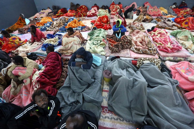 Migrants in a detention center in Libya