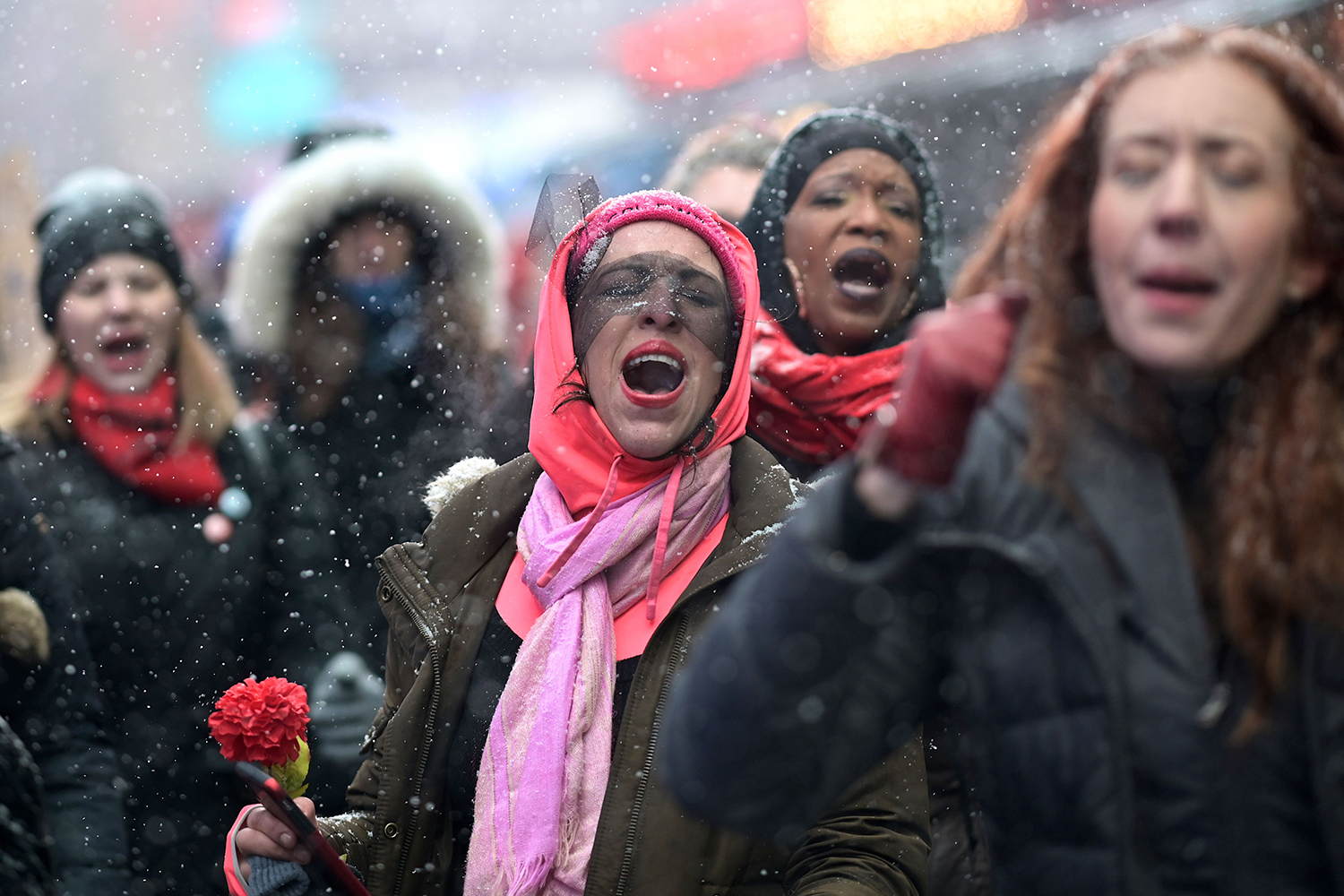 Women inspired by the Chilean feminist group Las Tesis dance during the Womens March in New York on Jan. 18. JOHANNES EISELE/AFP via Getty Images