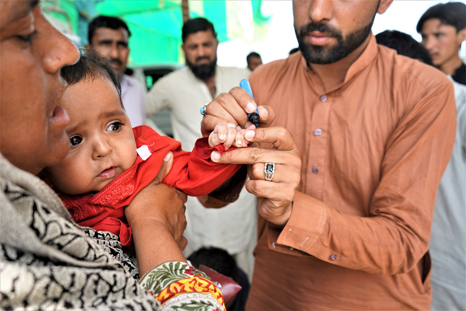 A child has his finger marked to indicate he has been vaccinated after receiving oral polio drops in Rawalpindi, Pakistan, on April 23, 2019. SABRINA TOPPA FOR FOREIGN POLICY