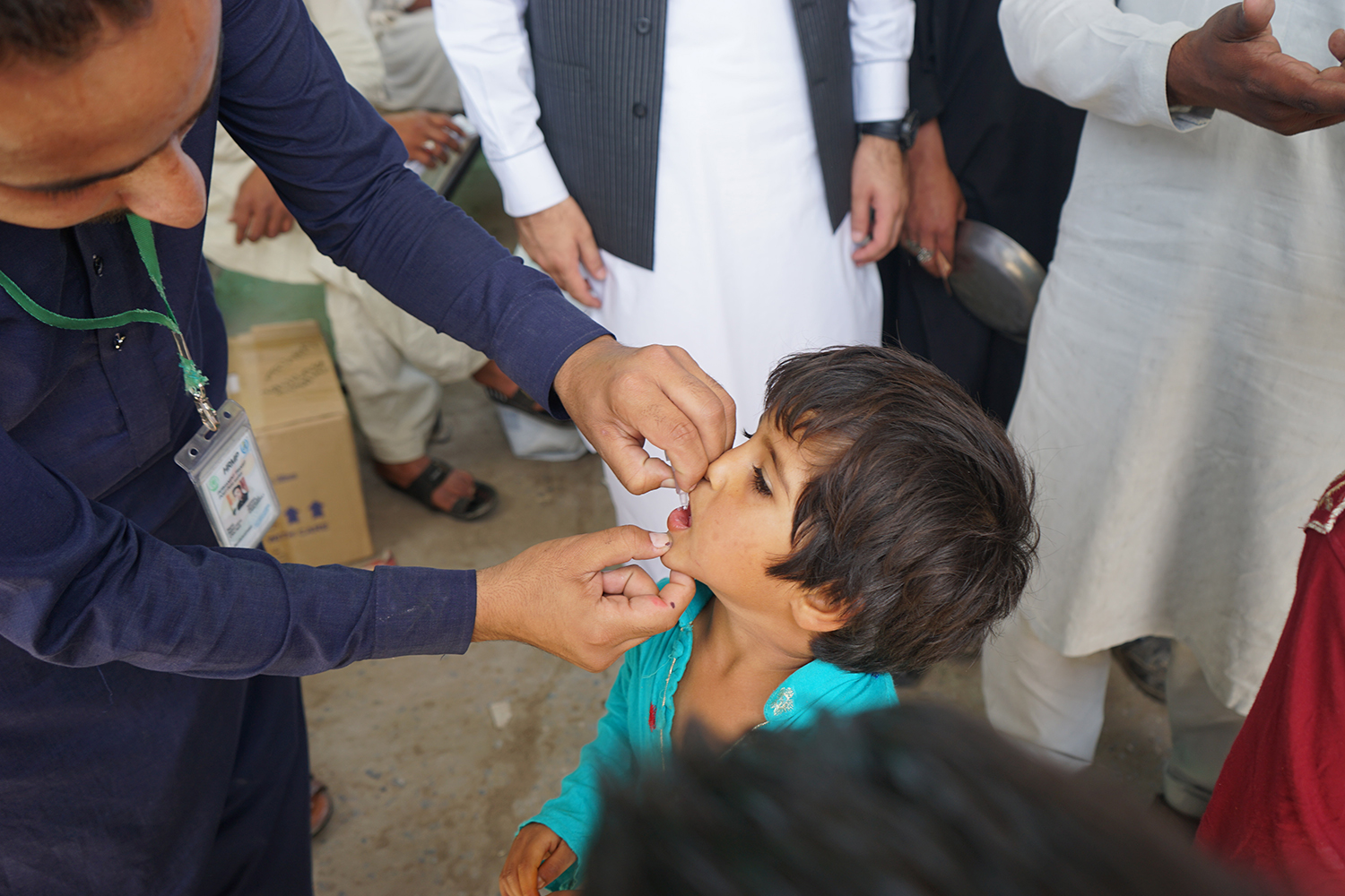 A child receives oral polio drops during a vaccination drive in Rawalpindi on April 23, 2019. SABRINA TOPPA FOR FOREIGN POLICY
