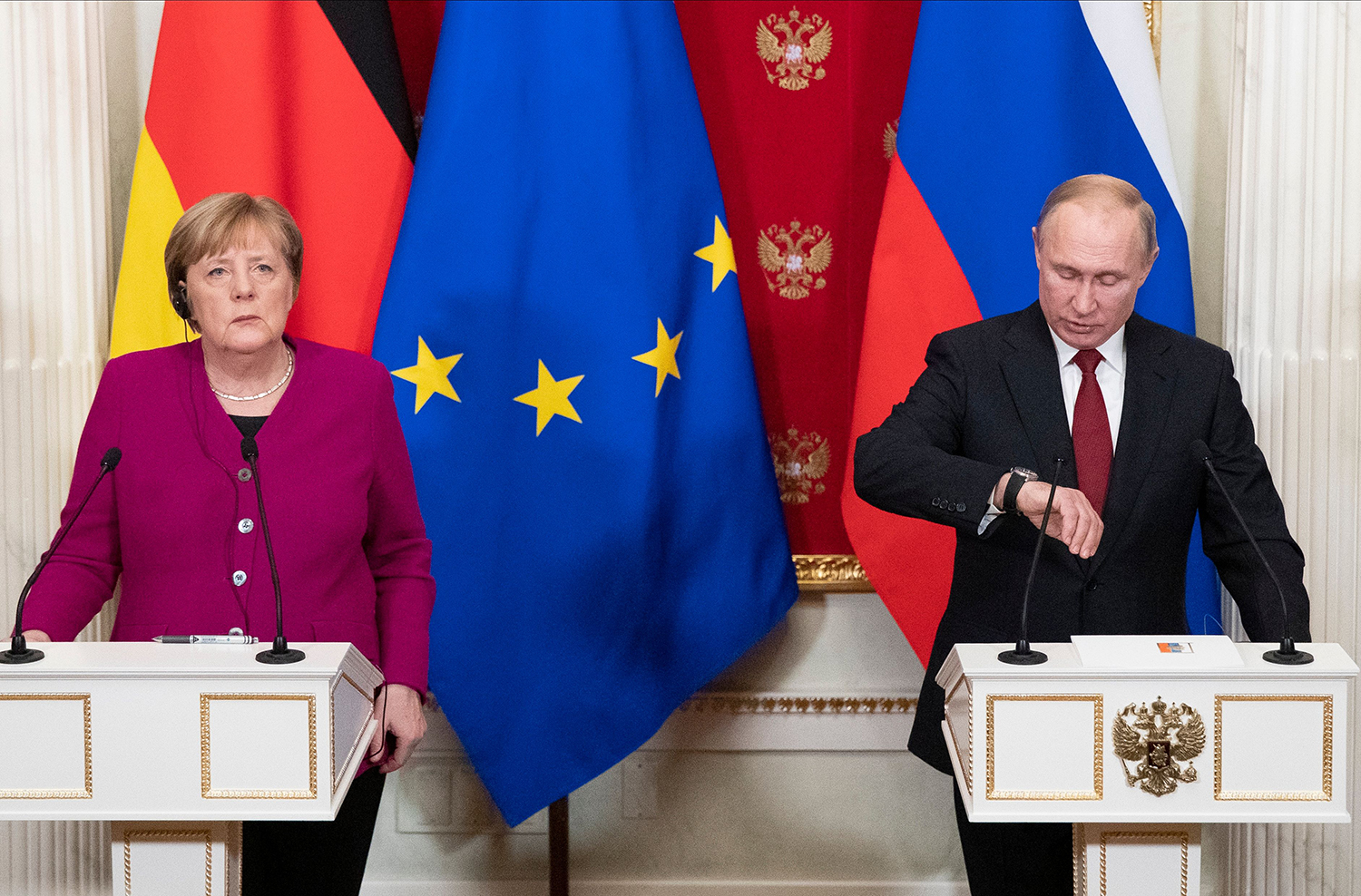 Russia's President Vladimir Putin and Germany's Chancellor Angela Merkel attend a joint news conference after their meeting at the Kremlin in Moscow on Jan. 11. PAVEL GOLOVKIN/POOL/AFP via Getty Images