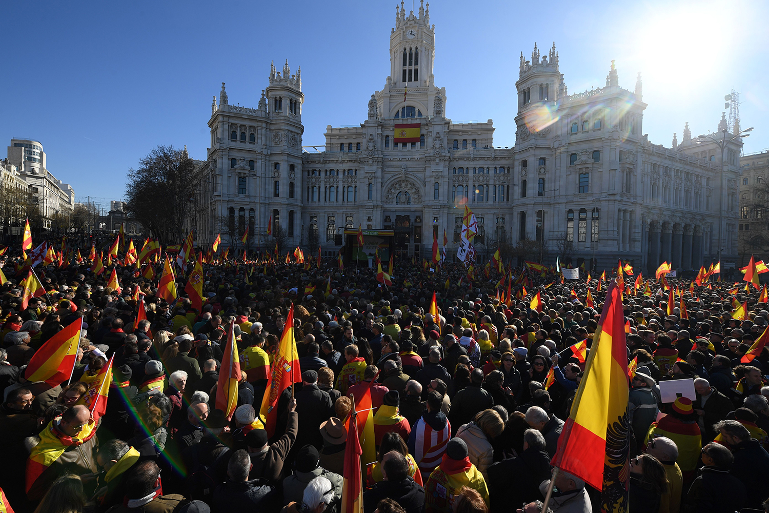 Supporters of Spanish far-right VOX party rally to protest against Spanish Prime Minister 's new coalition government in Madrid on Jan. 12. OSCAR DEL POZO/AFP via Getty Images